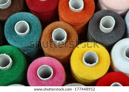 Colorful reels of threads background - stock photo