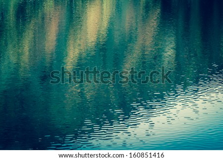 Colorful reflection in water. Abstract background. - stock photo