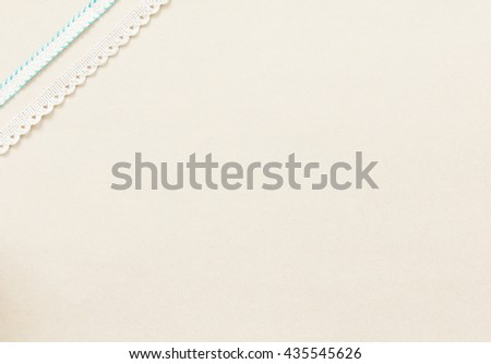 Colorful ribbon on soft brown paper background.