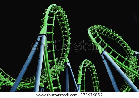 Colorful  roller coaster on black background - stock photo