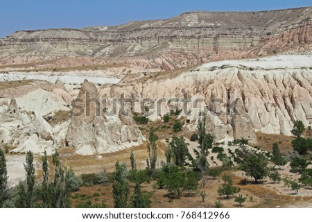 Colorful Rose valley mountain with blue sky in Cappadocia, Red canyon in Goreme village, Turkey. Popular tourist destination in Turkey for trekking.