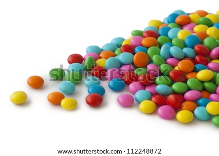 Colorful round candy on white background - stock photo