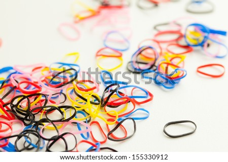 colorful rubber band on the table - stock photo