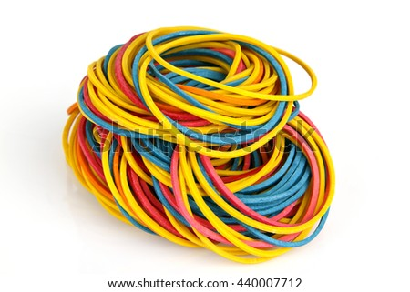 Colorful rubber bands on bright background - stock photo