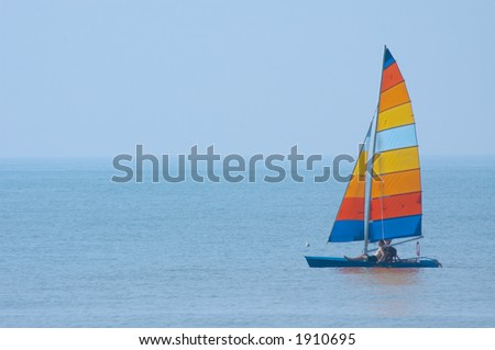 colorful sailboat and blue water