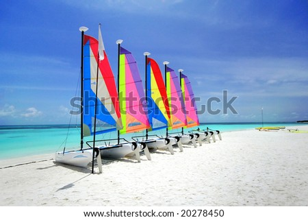 Colorful Sailing boat on the Tropical Nobody Beach of Romantic Honeymoon Resort Maldives
