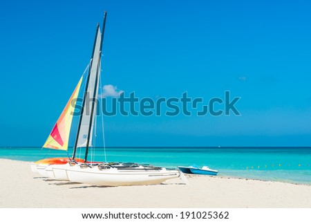 Colorful sailing boats for rent on a sunny day at Varadero beach in Cuba - stock photo