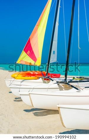 Colorful sailing boats on a sunny day at Varadero beach in Cuba - stock photo