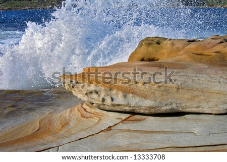 Colorful sandstone and frozen splash of the waves - stock photo