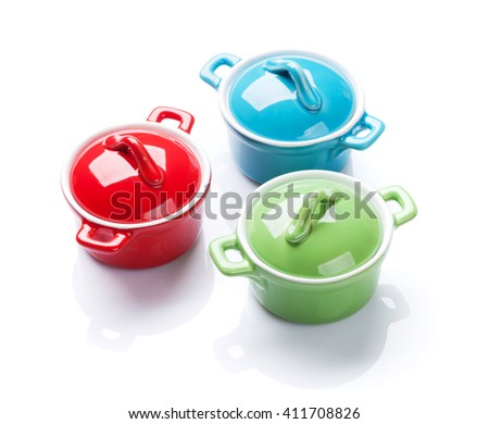 Colorful saucepans. Isolated on white background - stock photo