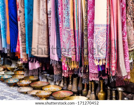 Colorful scarves and other souvenirs sold on a local market in Baku, Azerbaijan. Landscape orientation. - stock photo