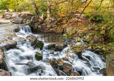 Colorful scenic Cascade in Virginia Water Park, UK - slow shutter speed effect