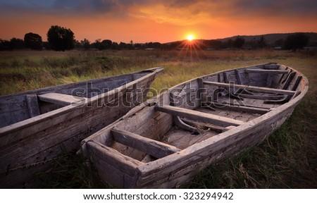 Colorful scenic sunrise with dramatic sky and fishing boats, Lake Tanganyika, Tanzania - stock photo