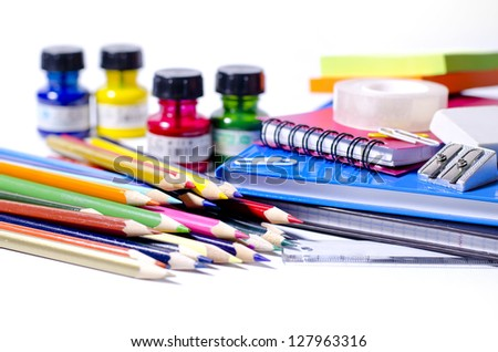 Colorful school supplies on white background - stock photo