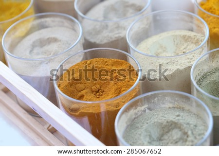 colorful seasoning in glass - stock photo
