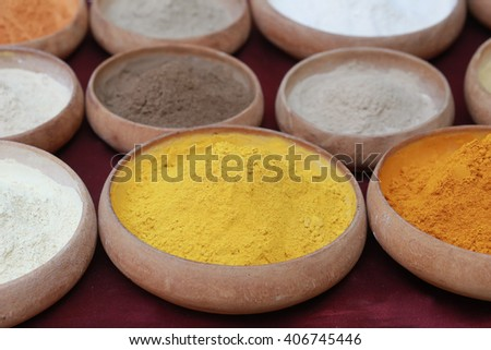 colorful seasoning powder, gorgeous setting with cooking spices and herbs (bay leaves, cumin, coriander, chili powder, cardamom pods, cinnamon sticks, paprika, piri piri, salt, turmeric) wooden pot - stock photo