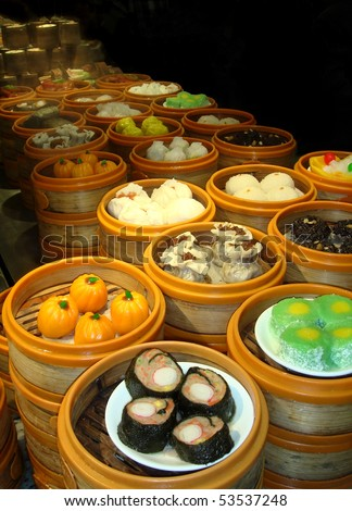 colorful selection of Dim Sum in bamboo steamer baskets - stock photo