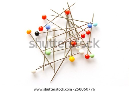 Colorful sewing pins isolated on white - stock photo