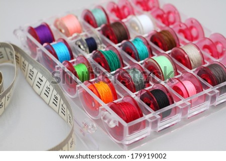 colorful sewing spools of thread for sewing - stock photo