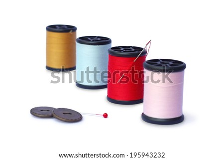 colorful sewing Threads isolated on white background - stock photo