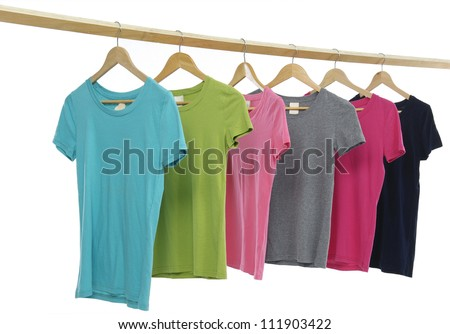 colorful shirt hanging on wooden hangers - stock photo