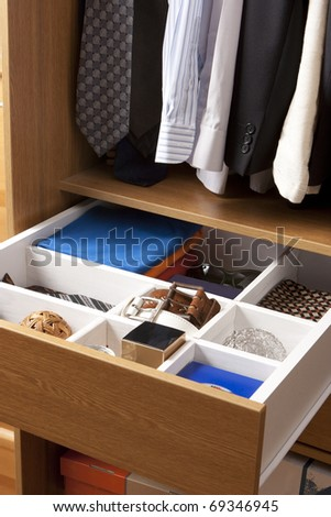 colorful shirt rack in wardrobe - stock photo