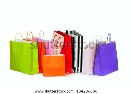Colorful shopping bags isolated on white. Shopping bags in different sizes and colors. - stock photo
