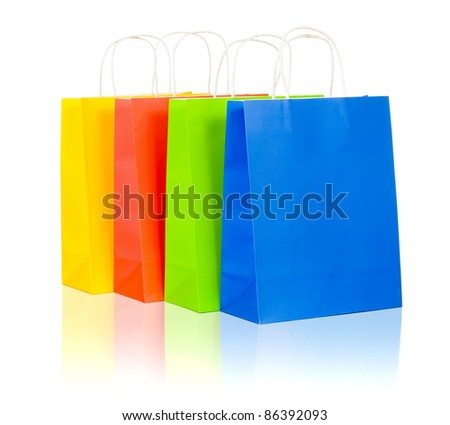 colorful shopping bags set including red, yellow, blue and green on white background