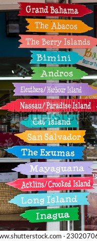 Colorful Signs Pointing to Islands in the Bahamas - stock photo