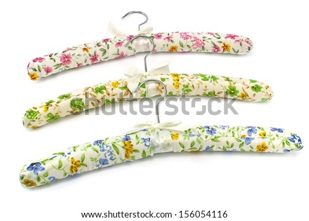 Colorful silk clothes hangers on white - stock photo
