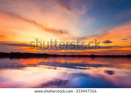 Colorful Sky After The Sunset In Cuyabeno National Park Ecuador Sucumbios Province Over Laguna Grande Polarized Image - stock photo