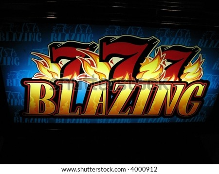 colorful slot machine sign in a casino - stock photo
