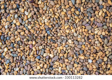 Colorful small pebbles or stone in garden. - stock photo