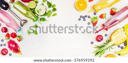 Colorful Smoothie bottles with fresh ingredients and blender on white wooden background, top view, banner. Superfoods and healthy lifestyle or detox  diet food concept. - stock photo