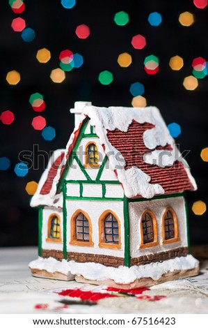 Colorful snow over children's house - stock photo
