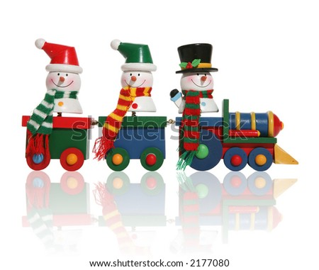 Colorful snowmen riding on a toy train - stock photo