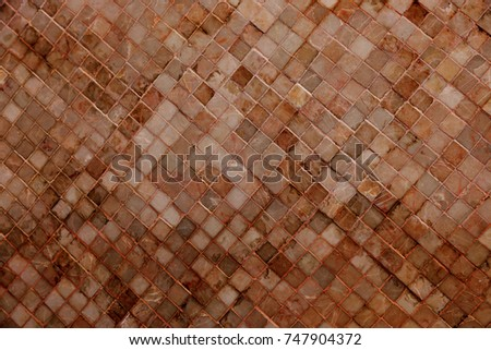 Colorful soft pastel monophonic Venetian mosaic as decorative decoration of facade. Venetian mosaic as decorative background. Selective focus. Abstract pattern. Abstract mosaic ceramic stones