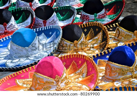 Colorful sombreros for sale at a market in Mexico. - stock photo
