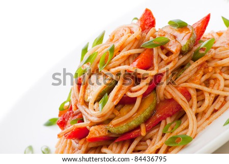 Colorful spaghetti with zucchini and tomato and grated cheese - stock photo