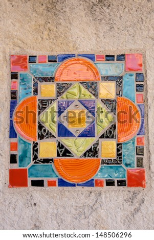 Colorful Spanish Ceramic Tile with Orange, Reddish, Bluish, Greenish, Yellowish Hues, and touches of Black