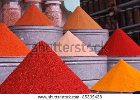 Colorful spice piles - stock photo