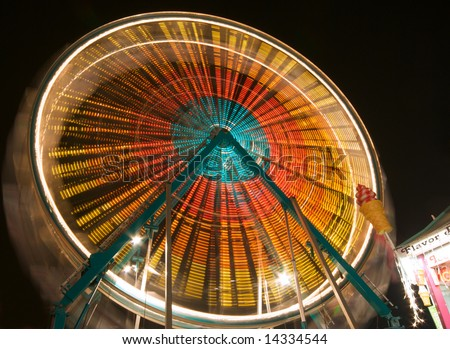 Colorful Spinning Ferris Wheel at Carnival