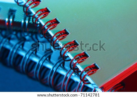 colorful spiral coil of book - stock photo