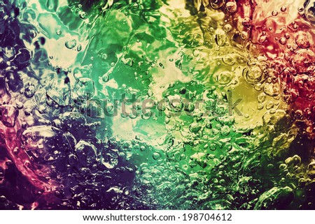 Colorful splashing, pouring water with bubbles. Colors of the rainbow. Background, pattern. - stock photo