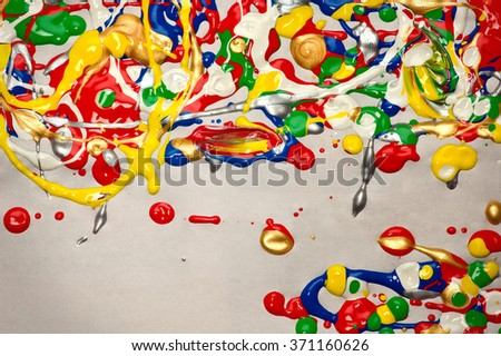 Colorful splatter paint abstract made with wet acrylic paints