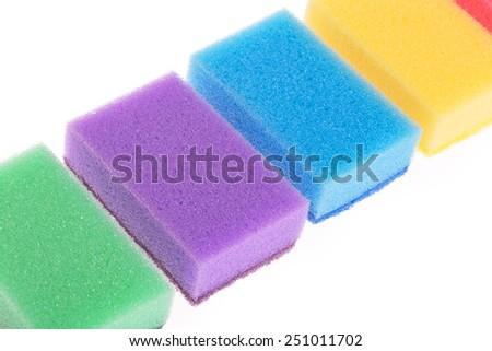 Colorful sponges isolated on white background - stock photo