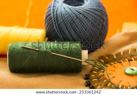 Colorful spools of thread in the foreground. Boho style. Sewing and embroidery. Embroidery thread - stock photo