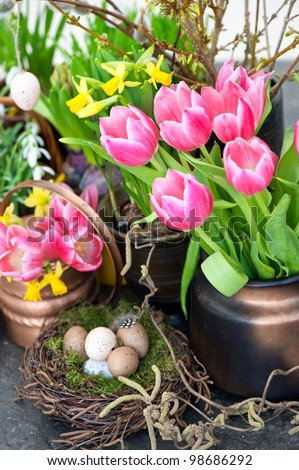 colorful spring flowers with easter decoration. tulips, snowdrops and narcissus blooms. selective focus - stock photo