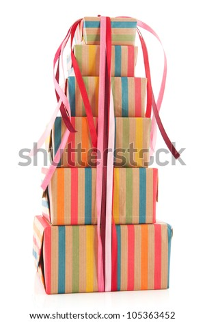 colorful stack with wrapped presents and flowers isolated on white background - stock photo