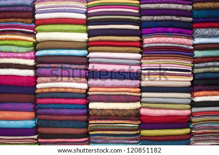 Colorful stacked fabric in a big market in Hanoi, Vietnam - stock photo